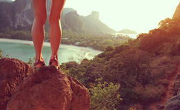 Woman hiker legs enjoy the view on mountain rock Stock Photography