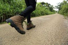 Woman hiker legs hiking Stock Images