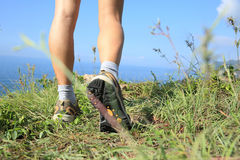 Woman hiker legs hiking on seaside mountain Royalty Free Stock Image