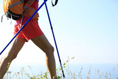 Woman hiker legs hiking on seaside mountain Stock Photography
