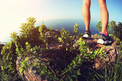 Woman hiker legs hiking on seaside mountain Royalty Free Stock Photo