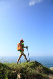 Woman hiker legs hiking on seaside mountain Royalty Free Stock Photography