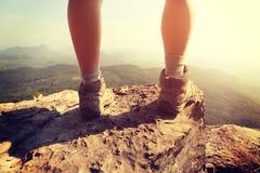 Woman hiker legs on  mountain peak rock Royalty Free Stock Photography