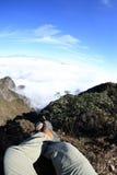 Woman hiker legs sit on beautiful mountain peak Royalty Free Stock Photos