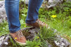 Woman hiker legs stand on mountain peak Royalty Free Stock Photos