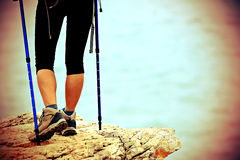 Woman hiker legs walking on seaside mountain trail Royalty Free Stock Images