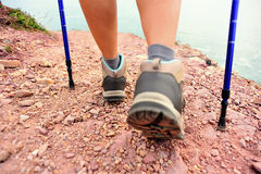 Woman hiker legs walking on seaside mountain trail Royalty Free Stock Photography