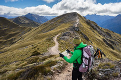 Woman hiker looing at the map of Kepler Track Stock Image