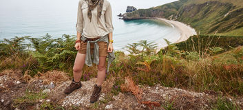 Woman hiker looking aside in front of ocean view landscape Royalty Free Stock Photo