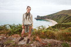 Woman hiker looking aside in front of ocean view landscape Royalty Free Stock Photos