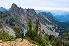 A Woman Hiker Looking Towards Mountains and Lake. Royalty Free Stock Photo