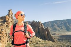 Woman hiker looking at view, backpacker adventure. Woman hiker reached mountain top. Inspire and motivate concept for outdoors activity. Female runner or climber royalty free stock images