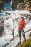 Woman hiker looking on waterfall. Tourism concept Stock Photography