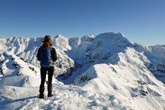 A Woman Hiker Looks Out Towards Mt Rolleston From the Summit of Avalanche Peak Royalty Free Stock Images