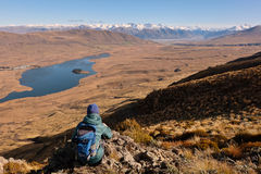 A Woman Hiker Looks Over Lake Clearwater Towards The Southern Alps. Stock Images