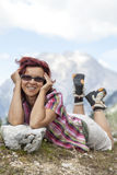 Woman hiker lying on the grass Stock Photography
