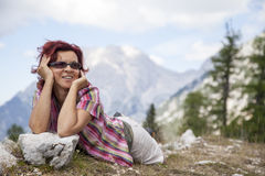 Woman hiker lying on the grass Stock Images
