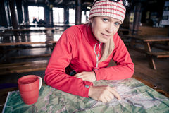 Woman hiker with map planning trip Stock Photography