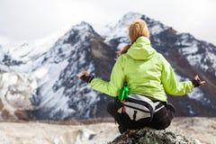 Woman Hiker Meditating on Rocks in Himalaya Mountains, Nepal Stock Photos