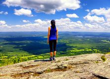 A woman hiker on Mount Race top Stock Photography