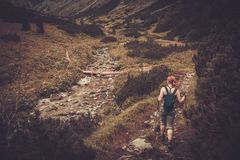 Woman hiker in mountain landscape Stock Image