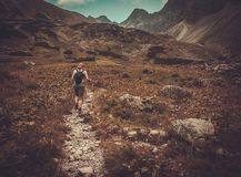 Woman hiker in mountain landscape Royalty Free Stock Images