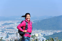 Woman hiker mountain peak Stock Image