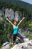 Woman hiker on the mountain peak Royalty Free Stock Photos
