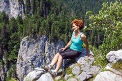 Woman hiker on the mountain peak Royalty Free Stock Photos