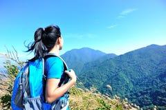 Woman hiker at mountain peak Royalty Free Stock Photos