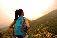 Woman hiker at mountain peak Stock Images