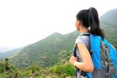 Woman hiker at mountain peak Stock Image