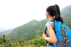 Woman hiker at mountain peak Stock Image