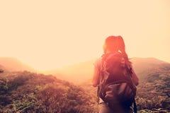Woman hiker at mountain peak Stock Photos
