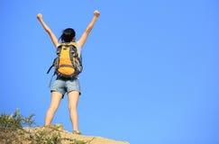 Woman hiker mountain peak Stock Images