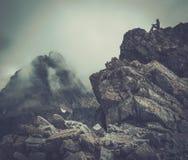 Woman hiker on a mountain Stock Photos