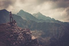 Woman hiker on a mountain Stock Images