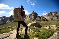 Woman hiker on mountain top rock. Successful woman hiker hiking in mountain top rock Stock Images