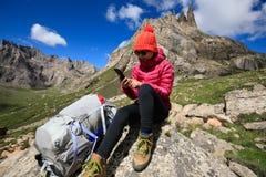 Woman hiker on mountain top rock. Successful woman hiker hiking in mountain top rock Royalty Free Stock Image