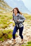 Woman hiker on a mountain trail Royalty Free Stock Image