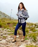 Woman hiker on a mountain trail Stock Photos