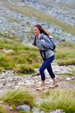Woman hiker on a mountain trail Stock Photo