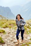 Woman hiker on a mountain trail Royalty Free Stock Photography