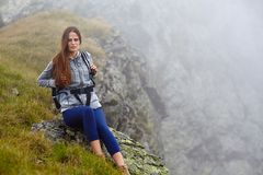 Woman hiker on a mountain trail Stock Photography