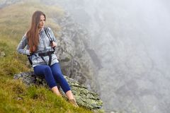 Woman hiker on a mountain trail Stock Image