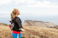 Woman hiker in mountains, arms outstretched Royalty Free Stock Image
