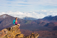 Woman hiker in the mountains enjoying the outdoors Stock Photo