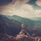 Woman hiker in a mountains Stock Image