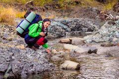 Woman hiker near the mountain stream Stock Photography