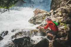Woman hiker near waterfall. Tourism concept Royalty Free Stock Photography